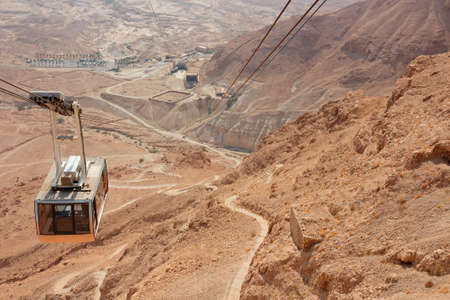 Desert landscape with cable car of the Masada cableway, Israel