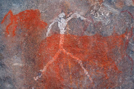Bushmen (san) rock painting of a human figure and animals, South Africa