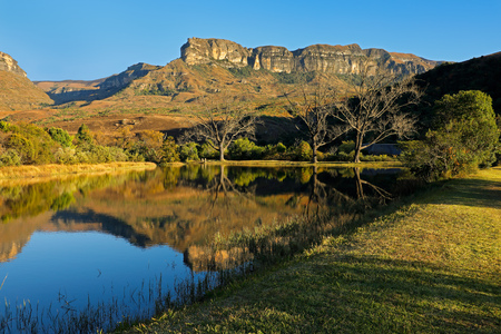 Sandstone mountains and pond with reflection in water, Royal Natal National Park, South Africa