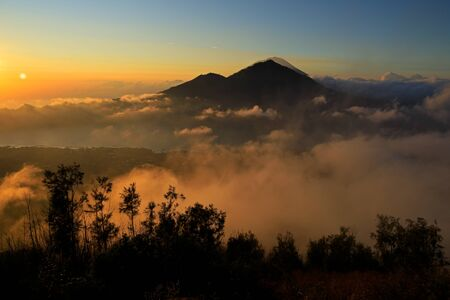 Scenic view of clouds and mist at sunrise from the top of mount Batur (Kintamani volcano), Bali, Indonesia