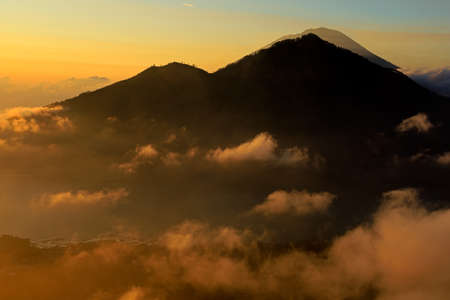 Scenic view of clouds and mist at sunrise from the top of mount Batur (Kintamani volcano), Bali, Indonesia Stock Photo - 150964921