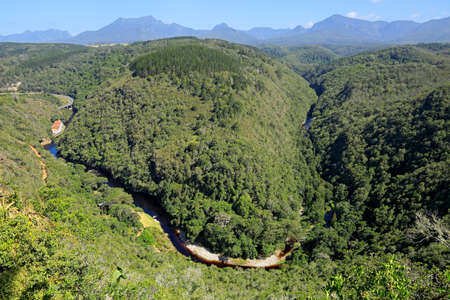 Scenic landscape with a river, forests and mountains on the Garden route of South Africa Stock Photo - 154907077