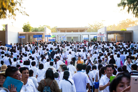 come in: Suphan Buri THAILAND -January, 2016 : crowd people in white dressing from Wat Phra Dhammakaya come to  Lotus land: Phramongkolthepmuni Nataive Place for invitation 1,131 Monks from Wat Phra Dhammakaya make a pilgrimage at  Lotus land : Phramongkolthepmuni