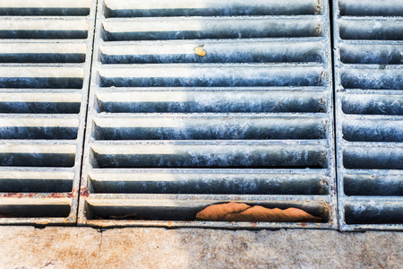 grate: Iron grate for sewers on the street