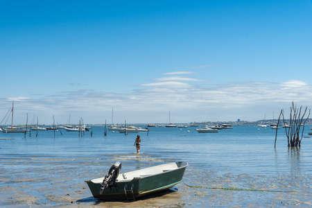 Arcachon Bay (France), young woman having a sea Stock Photo