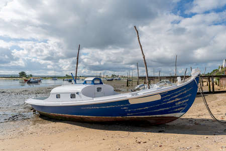 Arcachon Bay, France. The Cap Ferret, boats at low tide in front of the dune of Pilat