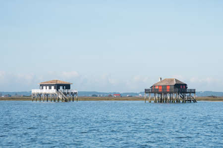 Arcachon Bay, France. The famous Tuscan Huts (huts on stilts) in front of the Island of Birds