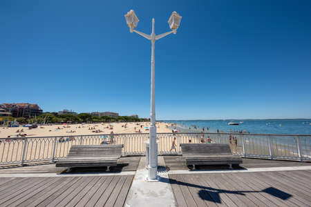 Arcachon, France, the beach and the jetty background Banque d'images - 104593516