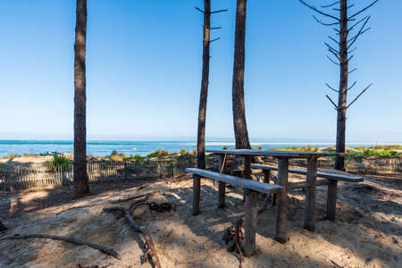 Arcachon Bay, France. Picnic table at seaside close to the dune of Pilat