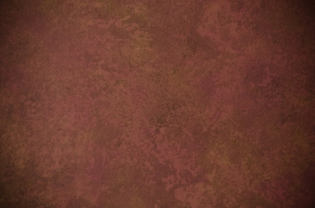 Classic dark red and brown painterly texture or background with subtle vignette and lighter center Reklamní fotografie