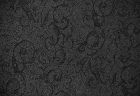 stylish faded black swirl texture or background with lovely floral and vine curls and patterns Archivio Fotografico