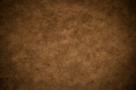 grunge textures: Classic brown painterly texture or background with subtle vignette and lighter center
