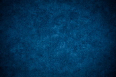indigo: Classic dark blue painterly texture or background with subtle vignette and lighter center