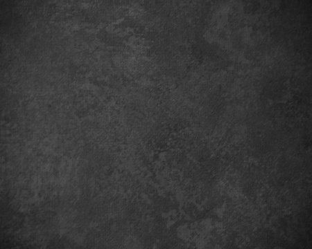 grunge textures: Classic black painterly texture or background with subtle vignette and lighter center