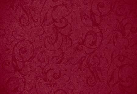 stijlvolle rode textuur krul of achtergrond met mooie bloemen en wijnstokken krullen en patronen Stockfoto