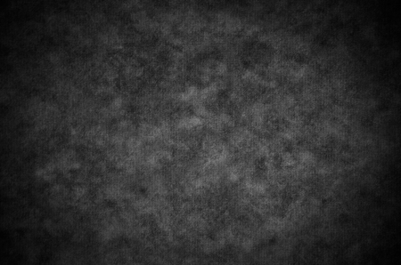 black onyx: Classic charcoal painterly texture or background with subtle vignette and lighter center