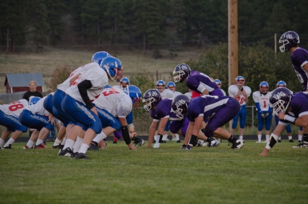 defensive: High school varsity offensive and defensive line prior to snap