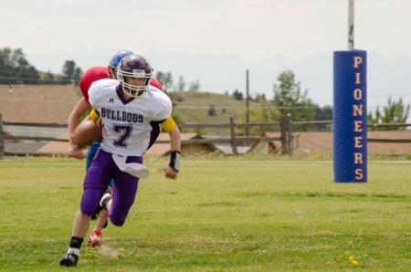 linemen: Cripple Creek, CO, 08312013, Football game: Elbert High School versus Cripple Creek-Victor High School Editorial