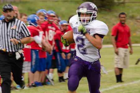 quarterback: Cripple Creek, CO, 08312013, Football game: Elbert High School versus Cripple Creek-Victor High School Editorial