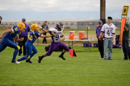 Sargent, CO, 09/14/2013, Football game: Elbert High School versus Dove Creek High School 版權商用圖片 - 22493547