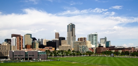 Downtown Denver skyline on sunny afternoon with baseball field in foreground