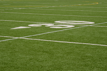 American Football 30 yard line marker in white on green artifical turf0 yard line marker in white on green artifical turf