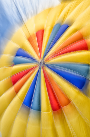 Abstract, motion-blur of colorful hot air balloon top photo