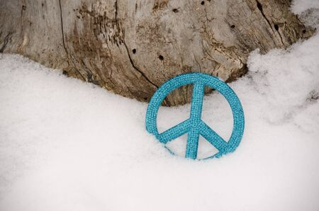 trees seasonal: blue peace sign ornament in snow