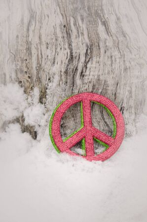 verticalred and green peace sign in snow