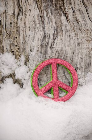 red and green peace sign in snow Archivio Fotografico