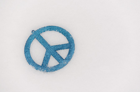 blue peace sign ornament isolated in snow2