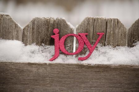 red letters spll joy against rustic fence4 Archivio Fotografico