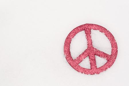 red peace sign isolated in snow2 Archivio Fotografico