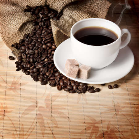 coffee maker: A sack of coffee beans and a cup