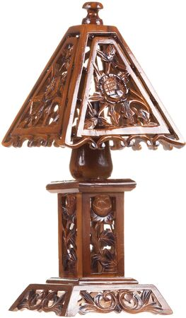 Carved wooden vintage table lamp isolated