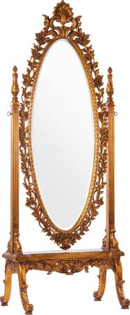 Big old mirror in a beautiful wooden carved frame 免版税图像