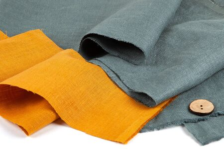 Orange and green fabric with buttons. Stock fotó