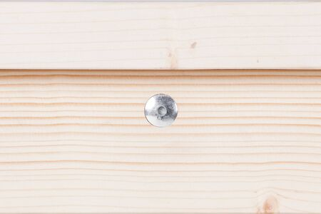 Wooden furniture close-up texture wirh screw isolated on white Stock Photo