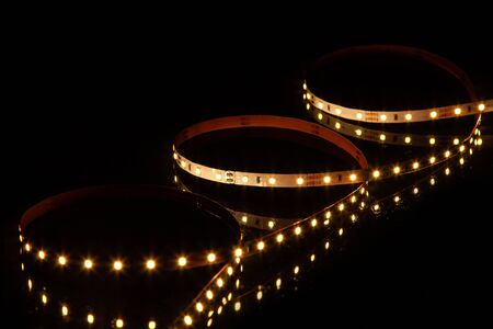 Yellow LED strip on black background