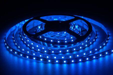 Blue LED strip on reel with black background