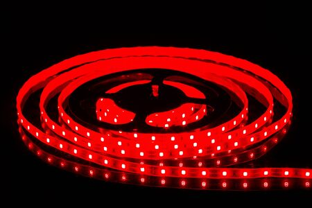 Red LED strip on reel with black background