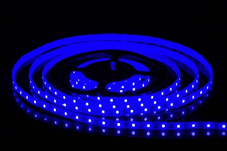 Blue LED strip on reel with black background