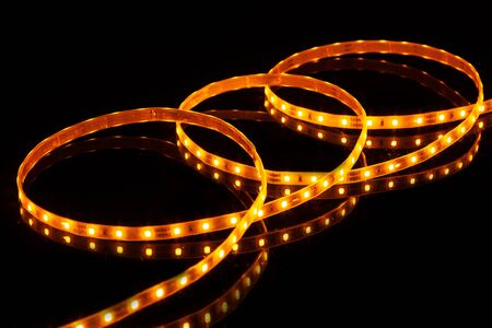 Yellow LED strip tape on black background Stock Photo