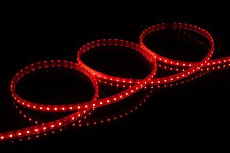 Red LED strip tape on black background