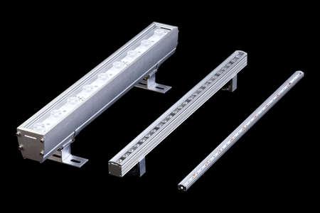Set of three aluminum LED flood light bars for energy saving idustrial or decorative lightning isolated on black background.