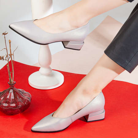 Woman legs in shoes on colorfull background.