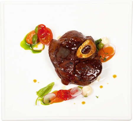 Grilled Beef steak on white square plate.