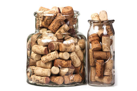 Wine corks in jars on a white background.