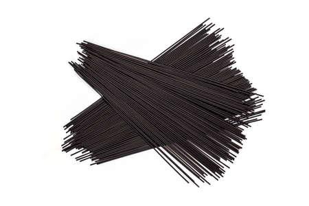Black spaghetti isolated on white background.