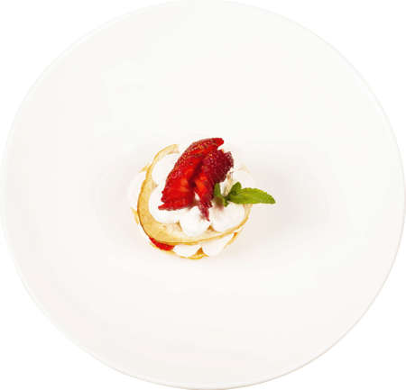 Dessert with fresh strawberries on white plate.